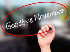 Man Hand writing Goodbye November with black marker on visual screen. Stock Photos