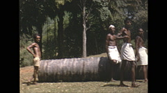 Vintage 16mm film, 1970, Ceylon, men rolling log heavy labour Stock Footage