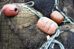 Close up of fishing net and buoys Stock Photos