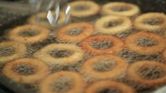 Stock Video Footage of Golden crispy onion rings frying