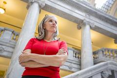 Stock Photo of Caucasian businesswoman standing in courthouse