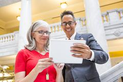 Business people using digital tablet in courthouse Stock Photos
