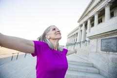 Caucasian woman standing outside courthouse Stock Photos