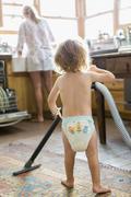 Caucasian boy helping mother do chores Stock Photos