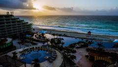 Cancun, Mexico resort sunrise with ocean waves and beach time lapse. Stock Footage