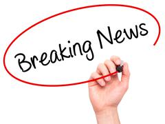 Man Hand writing Breaking News with black marker on visual screen. - stock photo