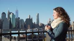 Woman looks at NYC skyline Stock Footage