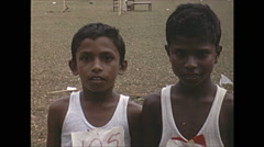 Vintage 16mm film, 1970, Ceylon, children two boys, close up Stock Footage