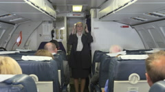 Stewardess demonstrates safety procedures on plane (part 1 of 2) Stock Footage