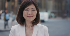 Slow Motion Portrait of beautiful Japanese businesswoman smiling Stock Footage