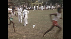 Vintage 16mm film, 1970, Ceylon, children two boys running - stock footage