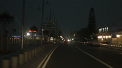 Car driving city street at night. Left-hand traffic rules observation. Accident Stock Footage