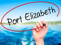 Stock Photo of Man Hand writing Port Elizabeth with black marker on visual screen