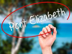 Man Hand writing Port Elizabeth with black marker on visual screen Stock Photos