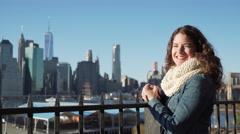 Woman looks at NYC skyline - stock footage