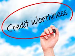 Man Hand writing Credit Worthiness with black marker on visual screen. - stock photo