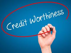 Man Hand writing Credit Worthiness with black marker on visual screen. Stock Photos