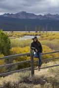 Caucasian woman under Sawtooth Range, Stanley, Idaho, United States Stock Photos