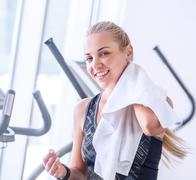 Attractive female with towel after Treadmill exercise - stock photo
