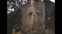 Vintage 16mm film, 1970, Ceylon, stone statue in hill Stock Footage