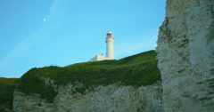 Flamborough Head Lighthouse & Moon in East Yorkshire Stock Footage
