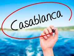 Man Hand writing Casablanca with black marker on visual screen. Stock Photos