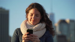 A beautiful woman texting Stock Footage