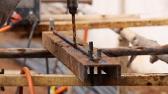 Drilling steel metal with hand drill Stock Footage