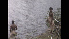 Vintage 16mm film, 1970, Ceylon, people bathing along river Stock Footage