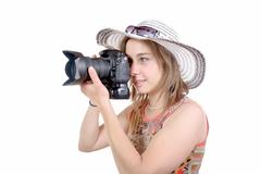 Young woman with a camera. youth lifestyle Kuvituskuvat