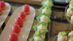 Catering sweets on table - stock footage