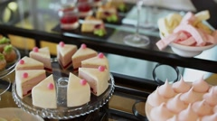 Various pieces of cake on a table Stock Footage