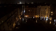 Prague cityscape, old town with church tower and traffic street by night Stock Footage