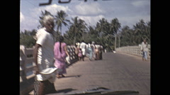 Vintage 16mm film, 1970, Ceylon, drive plate over rural bridge Stock Footage