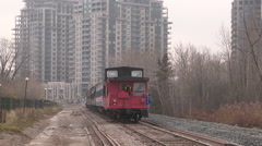 Steam coal engine locomotive rumbles along new rapid transit line construction Stock Footage