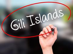 Man Hand writing Gili Islands with black marker on visual screen - stock photo