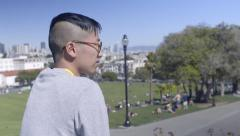 Man Looks Around At View Of Dolores Park And San Francisco Skyline Stock Footage