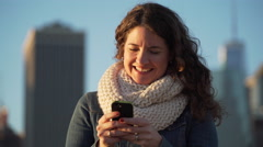 A beautiful woman is texting Stock Footage