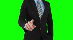 Businessman using an invisible touchscreen Stock Footage