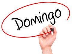 Hand writing Domingo (Sunday in Spanish/Portuguese) with marker Stock Illustration