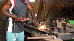 Africa welder man working city buba Stock Footage