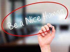 Man Hand writing Be a Nice Human with black marker on visual screen. - stock illustration