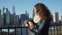 Woman looks at NYC skyline - stock footage