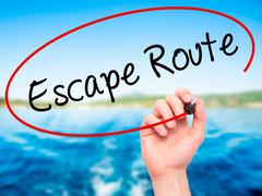 Man Hand writing Escape Route with black marker on visual screen - stock illustration