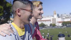 Gay Couple Enjoy Coffee And Conversation In Dolores Park, San Francisco Stock Footage