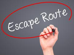 Stock Illustration of Man Hand writing Escape Route with black marker on visual screen