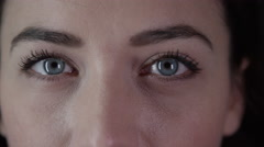 4K Close up on the eyes of a beautiful young woman Stock Footage
