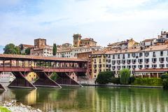 The old wooden bridge spans the river brenta at the village Basano del Grappa Stock Photos
