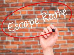 Man Hand writing Escape Route with black marker on visual screen Stock Illustration
