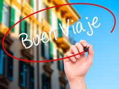 Stock Illustration of Man Hand writing Buen Viaje (Good Trip in Spanish) with marker on visual screen.